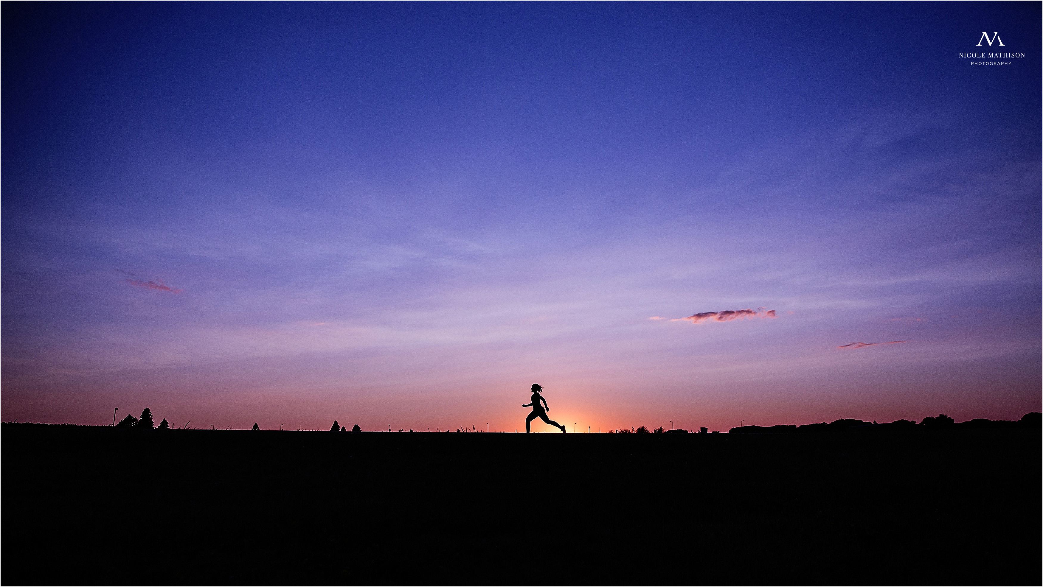 pink blue and purple sky running silhouette