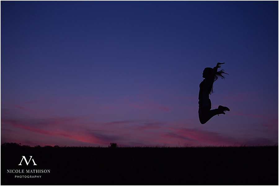 marie-rochester-mn-cross-country-runner-jumping-silhouette-with-dramatic-sky_0137