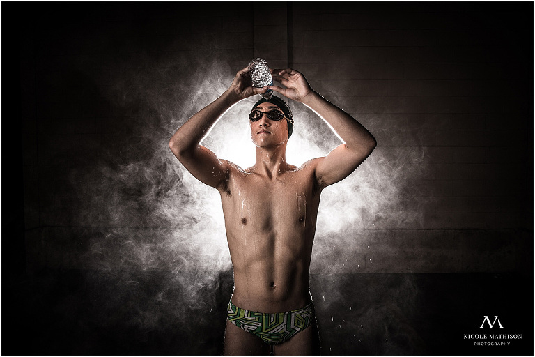 swimmer pouring water for senior photos